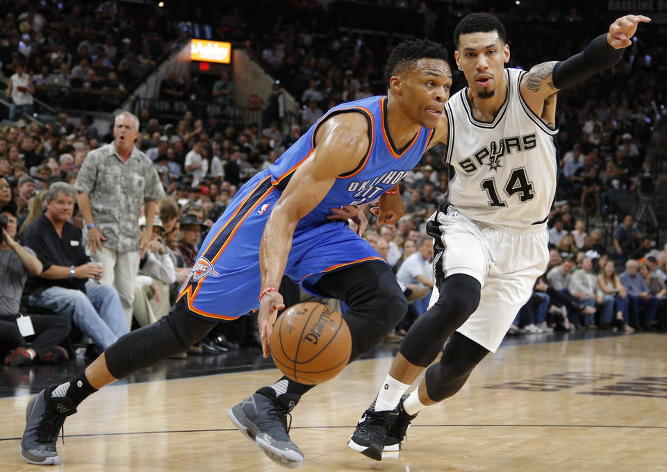Photo - Oklahoma City's Russell Westbrook (0) goes past San Antonio's Danny Green (14) during Game 5 of the second-round series between the Oklahoma City Thunder and the San Antonio Spurs in the NBA playoffs at the AT&T Center in San Antonio, Tuesday, May 10, 2016. Oklahoma City won 95-91. Photo by Bryan Terry, The Oklahoman