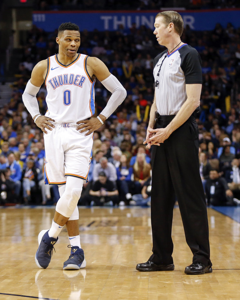 Photo - Oklahoma City's Russell Westbrook (0) talks to official Ed Malloy (14) during an NBA basketball game between the Oklahoma City Thunder and the Sacramento Kings at Chesapeake Energy Arena in Oklahoma City, Monday, March 12, 2018. Oklahoma City won 106-101. Photo by Nate Billings, The Oklahoman