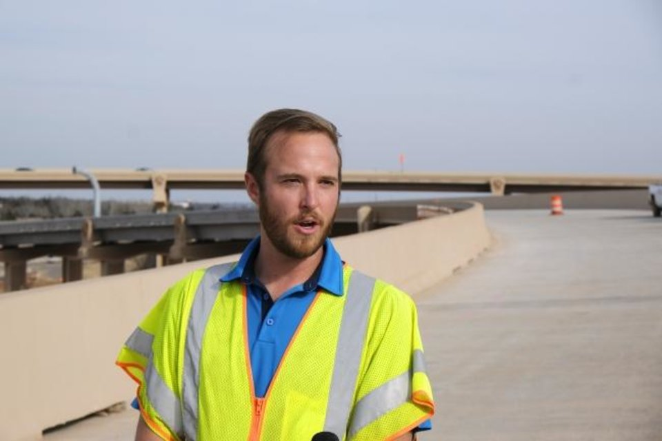 Photo - Jeff Garner, Project Engineer, speaks with the media on the flyover bridge that takes traffic from eastbound I-44 to northbound I-235 Wednesday, February 3, 2021. [Doug Hoke/The Oklahoman]