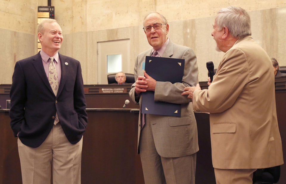 Photo -  Oklahoma City Mayor Mick Cornett, left, and Ward 4 Councilman Pete White, right, congratulate Ward 8 Councilman Pat Ryan on the final day of his 10 years in the position, during the Oklahoma City Council meeting in Oklahoma City, OK, Tuesday, April 7, 2015, Photo by Paul Hellstern, The Oklahoman   PAUL HELLSTERN -  Oklahoman
