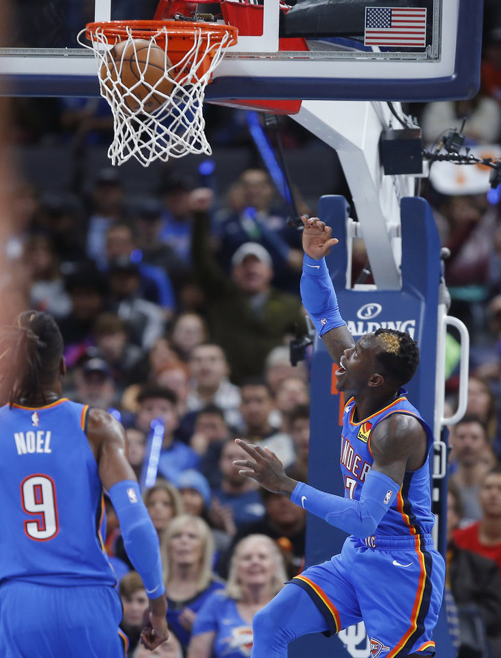 Photo - Oklahoma City's Dennis Schroder (17) smiles as he makes a basket during an NBA basketball game between the Oklahoma City Thunder and the New Orleans Pelicans at Chesapeake Energy Arena in Oklahoma City, Saturday, Nov. 2, 2019. Oklahoma City won 115-104. [Bryan Terry/The Oklahoman]