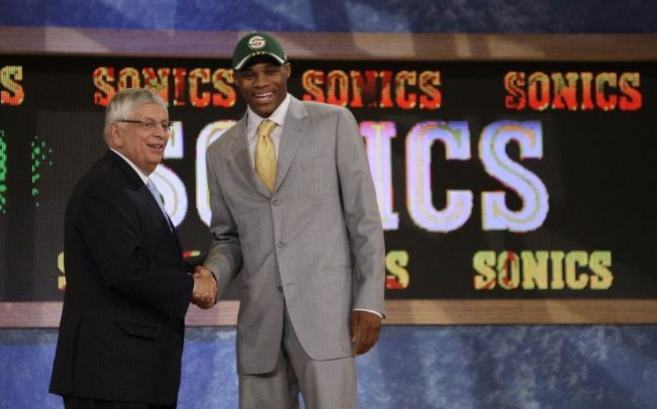Photo -  UCLA's Russell Westbrook, right, is congratulated by NBA commissioner David Stern after being picked fourth overall by the Seattle SuperSonics in 2008. [AP Photo/Julie Jacobson]