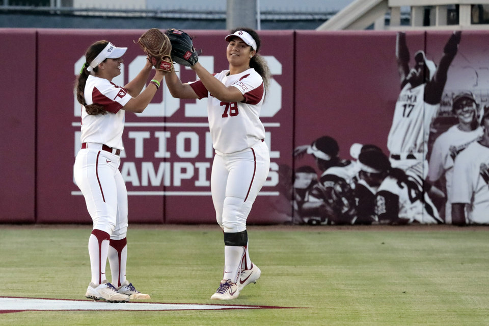 Photo - Sooners Nicole Mendes and Jocelyn Alo celebrate an out in Bedlam softball as the University of Oklahoma Sooners (OU) play the Oklahoma State Cowboys (OSU) at Marita Hynes Field at the OU Softball Complex on  May 4, 2019 in Norman, Okla.  [Steve Sisney/For The Oklahoman]