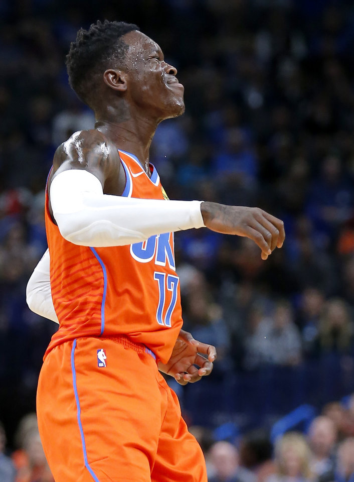 Photo - Oklahoma City's Dennis Schroder (17)  reacts after a basket during the NBA game between the Oklahoma City Thunder and the Milwaukee Bucks at Chesapeake Energy Arena,   Sunday, Nov. 10, 2019.  [Sarah Phipps/The Oklahoman]