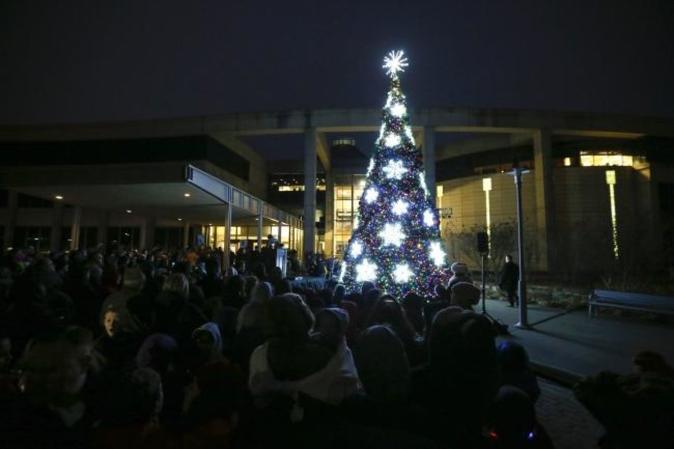 Photo -  The tree is lit during the Governor's Christmas Tree Lighting on Monday.