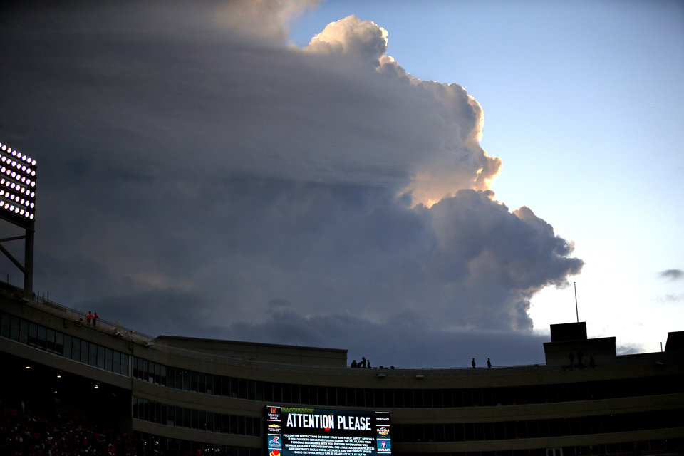 Photo - Storm clouds build behind Boone Pickens Stadium just before a weather delay during the college football game between the Oklahoma State Cowboys and the Kansas State Wildcats at Boone Pickens Stadium in Stillwater, Okla., Saturday, Sept. 28, 2019. [Sarah Phipps/The Oklahoman]