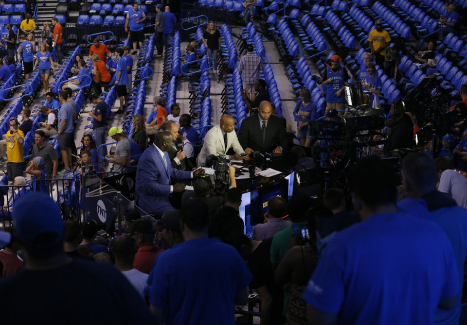 Photo - Fans gather around the TNT set before during Game 6 of the Western Conference finals in the NBA playoffs between the Oklahoma City Thunder and the Golden State Warriors at Chesapeake Energy Arena in Oklahoma City, Saturday, May 28, 2016. Photo by Sarah Phipps, The Oklahoman