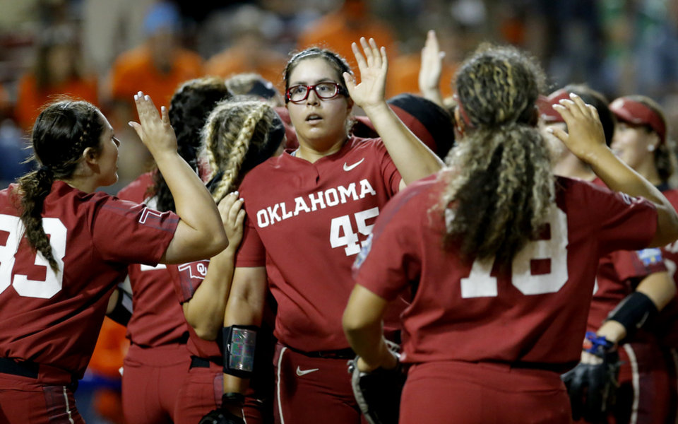 Photo - Oklahoma's Giselle Juarez (45) celebrates with teammates during a Women's College World Series between Oklahoma State (OSU) and Oklahoma at USA Softball Hall of Fame Stadium in Oklahoma City,  Friday, May 31, 2019.  [Sarah Phipps/The Oklahoman]