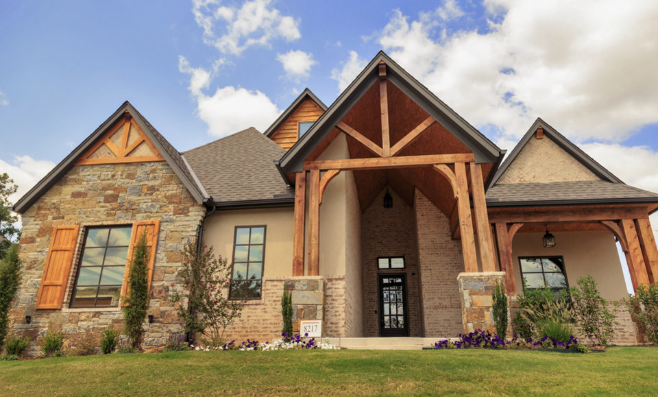 Photo -  Foster Signature Homes built this Parade of Homes entry at 8217 Ridge Creek Road in the Ridge Creek addition, which it also developed, southwest of Douglas Boulevard and Coffee Creek Road in Edmond. Ridge Creek is the featured neighborhood in the Parade of Homes Fall Classic. [PHOTO BY CHRIS LANDSBERGER, THE OKLAHOMAN]