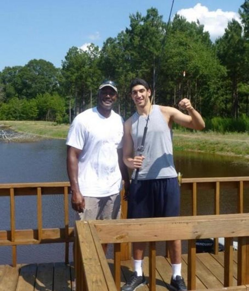 Photo - Enes Kanter fishing with former Utah Jazz legend Karl Malone in 2013. Photo/Twitter