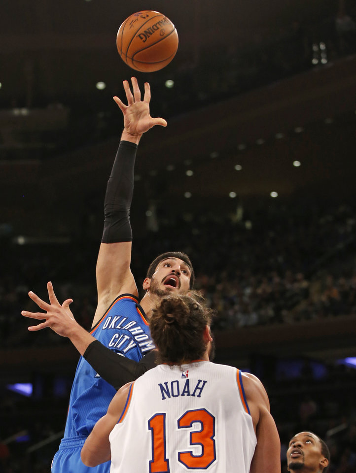 Photo - Oklahoma City Thunder center Enes Kanter (11) shoots over New York Knicks' center Joakim Noah (13) in the first half of an NBA basketball game at Madison Square Garden in New York, Monday, Nov. 28, 2016. (AP Photo/Kathy Willens)