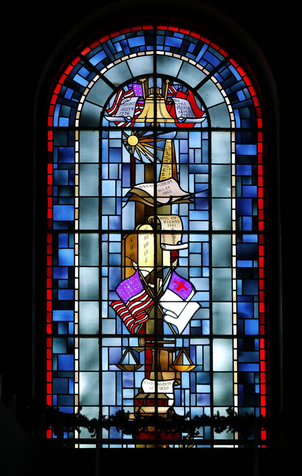 Photo -  A stained glass window in Raley Chapel at Oklahoma Baptist University is shown in this photo after an image of the Confederate flag and a Nazi swastika was removed from it. The Confederate flag was replaced with an image of the Christian flag.[Photo By Steve Gooch, The Oklahoman]
