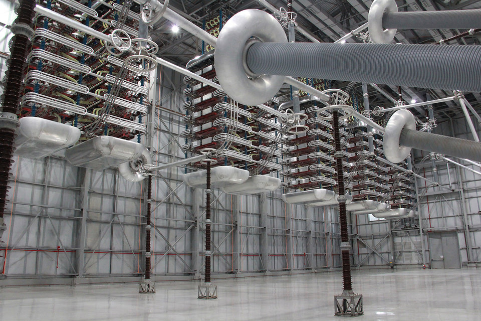 Photo -  The valve hall of a high-voltage, direct-current converter station is shown in this photo. In the foreground are transformer bushings coming in from the AC yard, while in the background are the valves to convert alternating current to direct current for long-distance electricity transmission. [Photo provided]