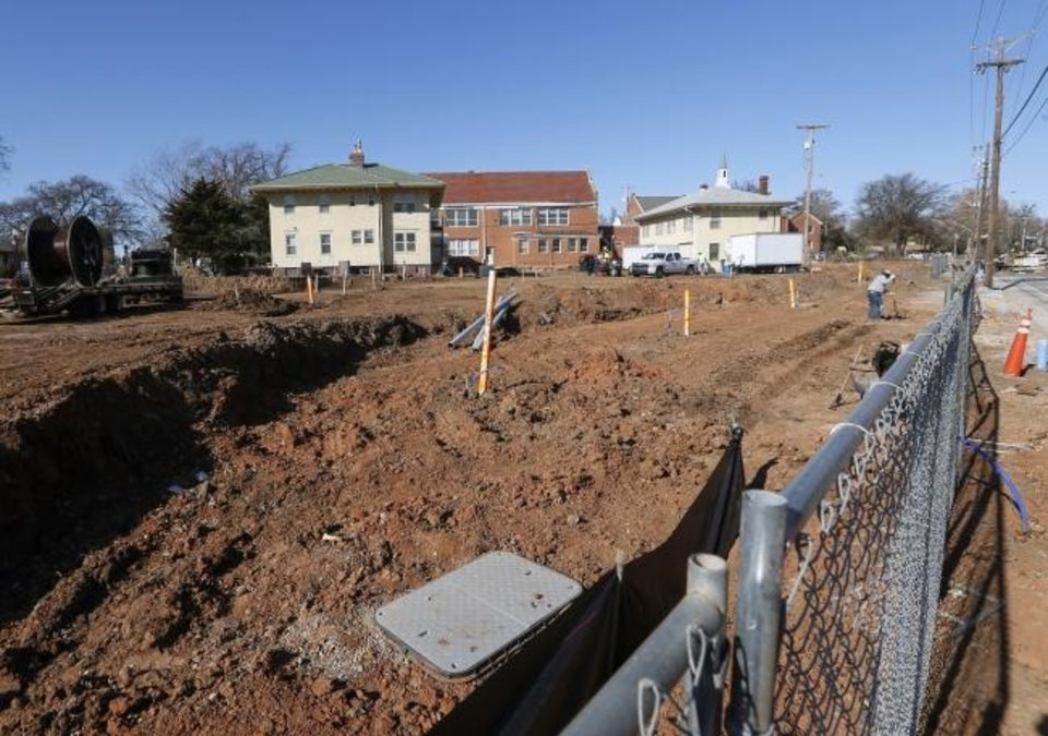 Photo -  Site work is underway for townhouses being built along the eastern edge of the former Villa Teresa School, next to Dewey between NW 12 and NW 10. [Nate Billings/The Oklahoman]