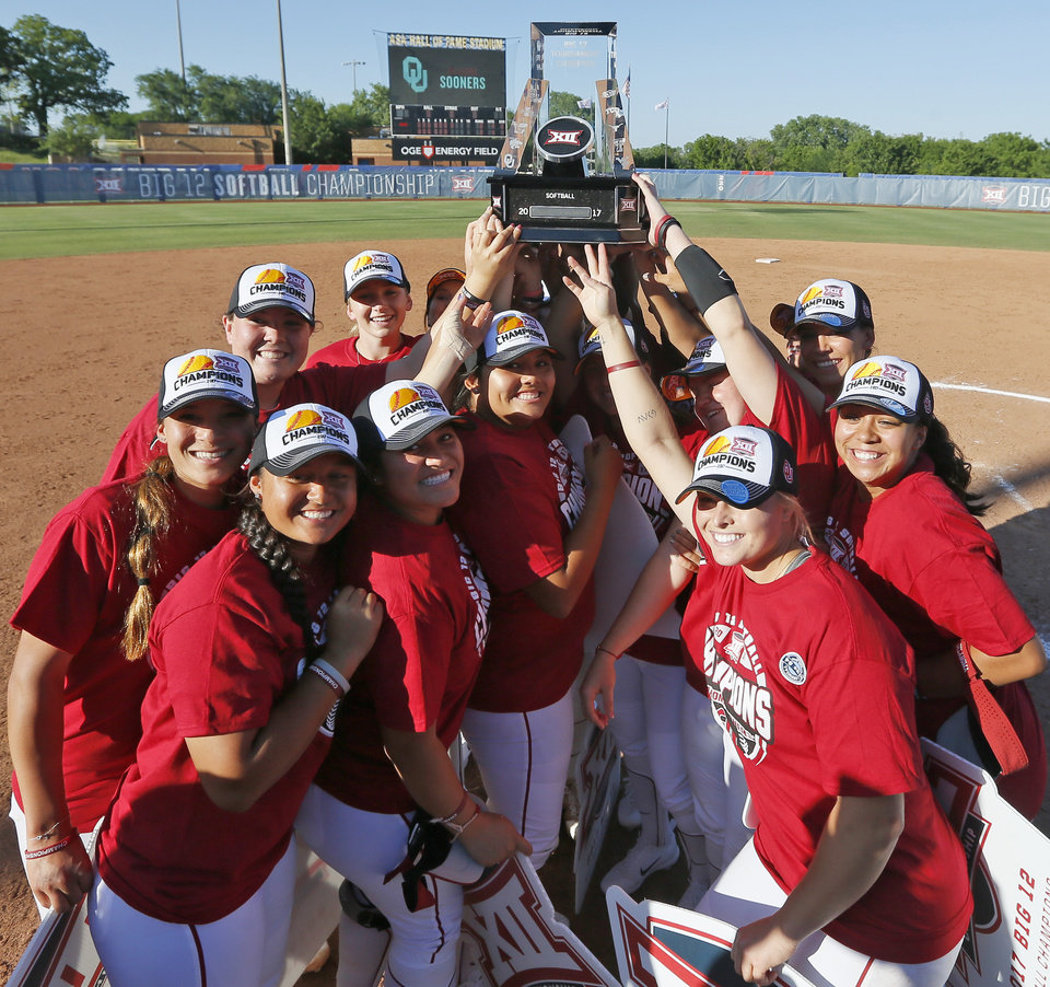 Photo - The Sooners pose for a photo after the championship game of the Big 12 softball tournament between Oklahoma and Oklahoma State at ASA Hall of Fame Stadium in Oklahoma City, Saturday, May 13, 2017. OU won 2-0. Photo by Nate Billings, The Oklahoman