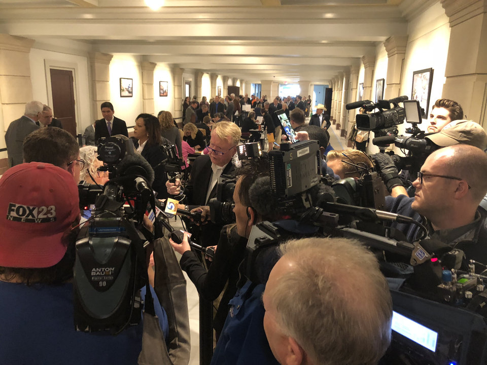 Photo - The media crowds around Haskell teacher Cyndi Ralston, one of the first teachers to file for office (HD 12) today. Photo by Dave Morris