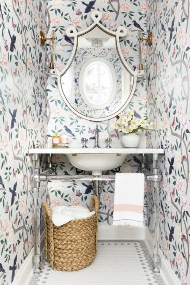 Photo -  A powder room by Bria Hammel pairs a more subdued mosaic floor with bold wallpaper. [SPACECRAFTING PHOTOGRAPHY]