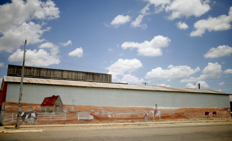 Photo - A mural on the side of building in downtown Muleshoe, Texas, hometown of Oklahoma's offensive coordinator Lincoln Riley is seen on Thursday, June 25, 2015. Photo by Bryan Terry, The Oklahoman