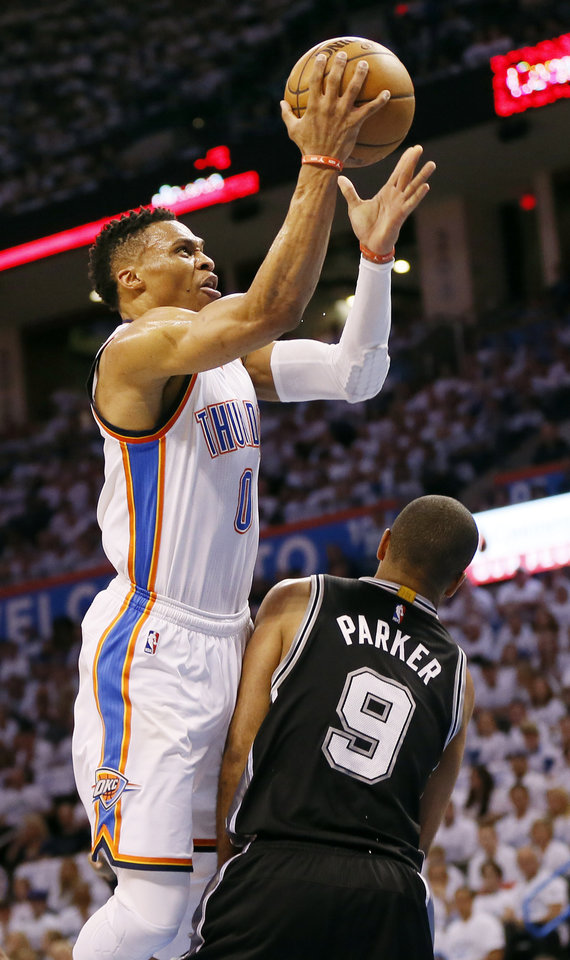 Photo - Oklahoma City's Russell Westbrook (0) takes the ball to the hoop against San Antonio's Tony Parker (9) during Game 4 of the Western Conference semifinals between the Oklahoma City Thunder and the San Antonio Spurs in the NBA playoffs at Chesapeake Energy Arena in Oklahoma City, Sunday, May 8, 2016. Photo by Nate Billings, The Oklahoman