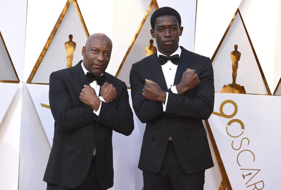 Photo - John Singleton, left, and Damson Idris arrive at the Oscars on Sunday, March 4, 2018, at the Dolby Theatre in Los Angeles. (Photo by Jordan Strauss/Invision/AP)