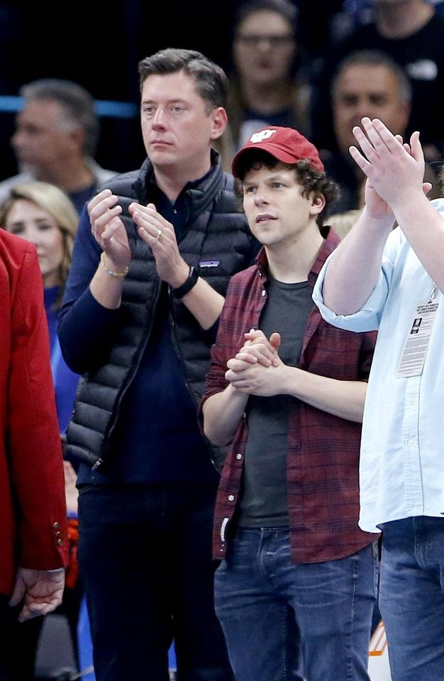 Photo - Oklahoma City Mayor David Holt watches the game with actor Jesse Eisenberg during the NBA game between the Oklahoma City Thunder and the Milwaukee Bucks at Chesapeake Energy Arena,   Sunday, Nov. 10, 2019.  [Sarah Phipps/The Oklahoman Archives]