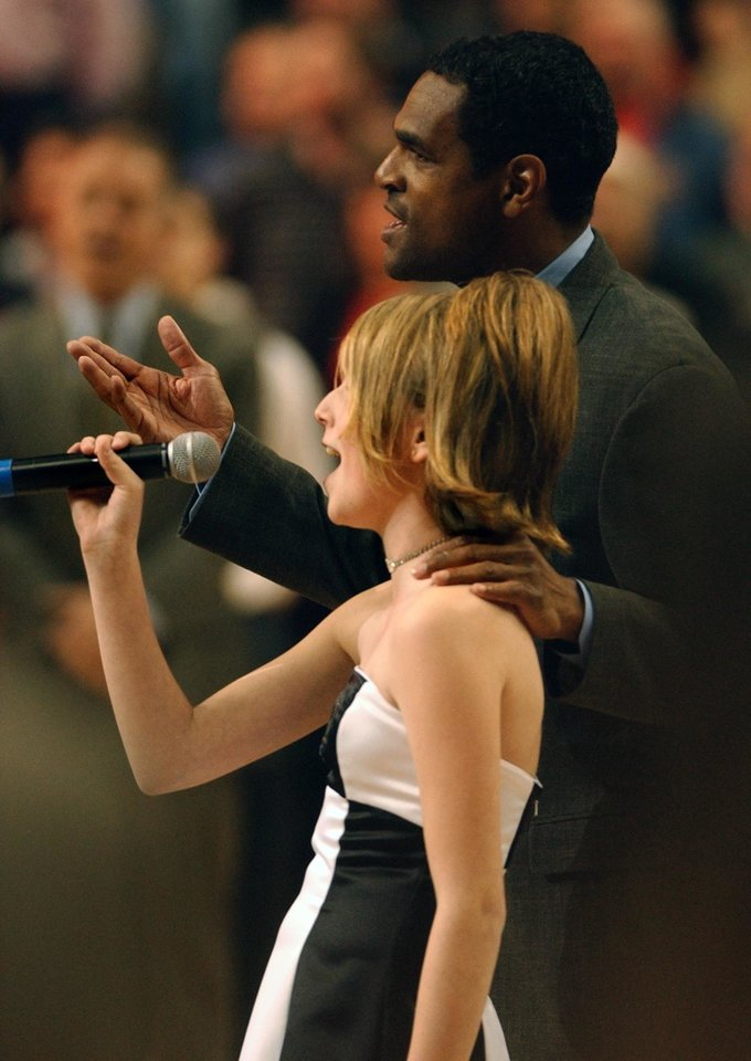 Photo - NBA basketball playoffs - Portland Trail Blazers vs Dallas Mavericks - April 25, 2003. 1ST QUARTER. Natalie Gilbert has a little help from coach Maurice Cheeks singing the national anthem. (Bruce Ely 381-2530) ORG XMIT: 0910312208409144