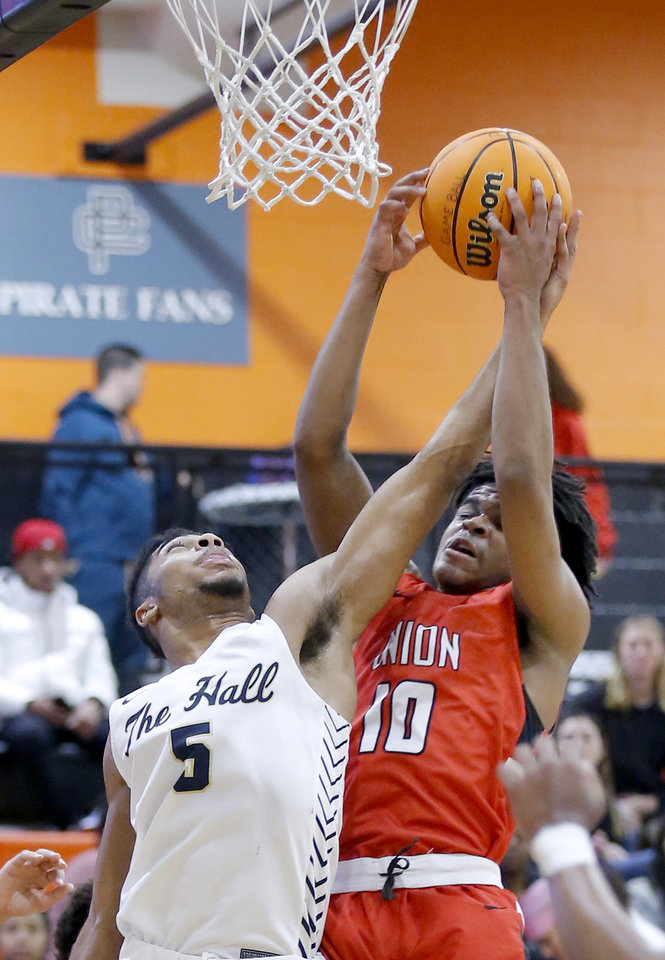Photo - Heritage Hall's Phillip Smitherman fights Union's RJ Forney for a rebound during the boys championship game between Heritage Hall  and Tulsa Union at the Putnam City Invitational at Putnam City High School in Oklahoma City, Okla.,  Saturday, Jan. 11, 2020.  [Sarah Phipps/The Oklahoman]