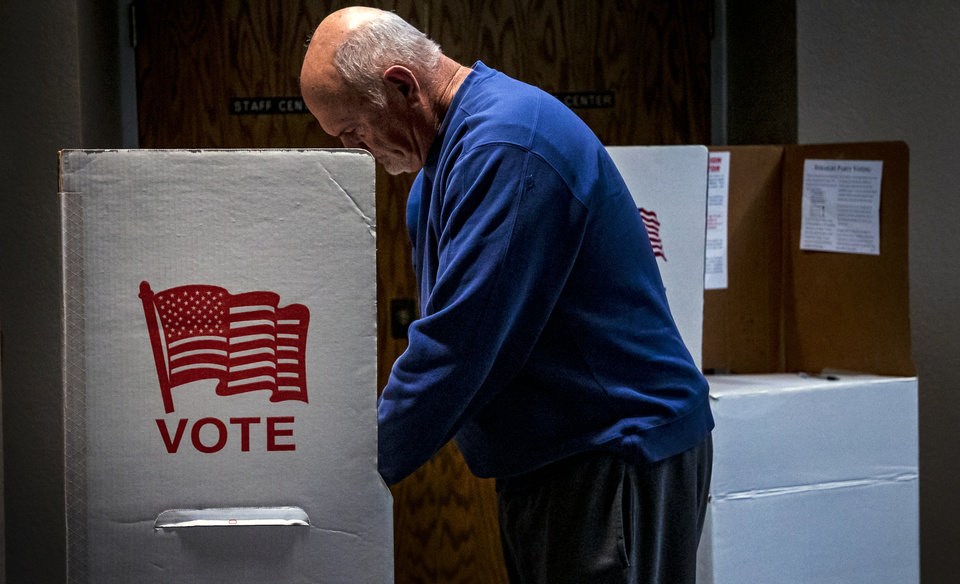 Photo - Don Tidholm fills out his ballot to vote at his voting precinct in the Church of the Good Shepherd in Yukon, Okla. on Tuesday, Dec. 10, 2019.   [Chris Landsberger/The Oklahoman]