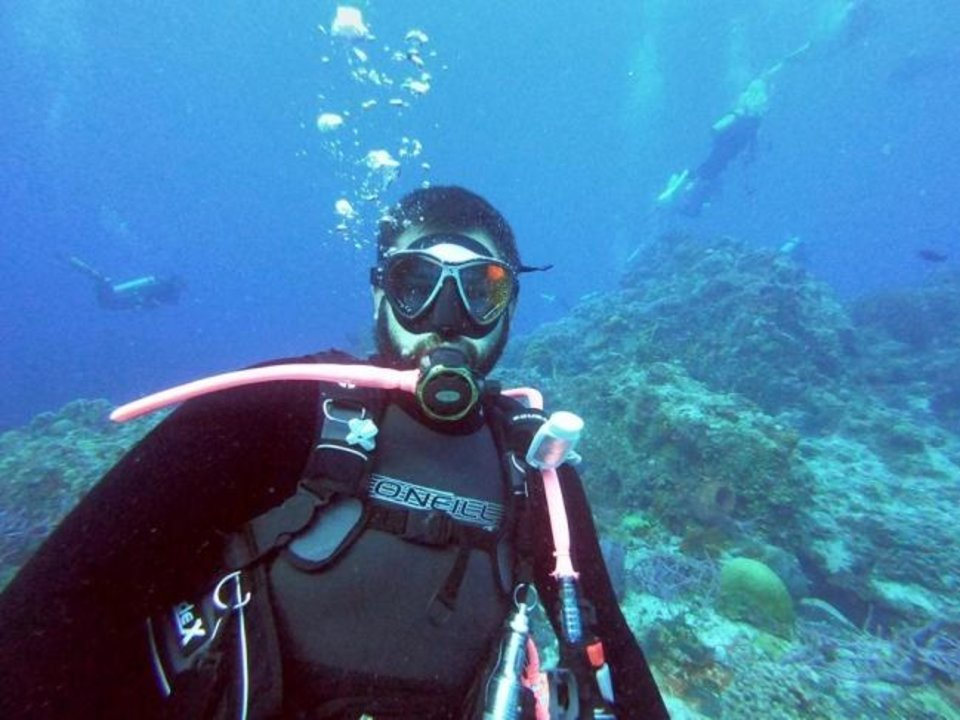 Photo -  Blake Mitchell, 30, of Mustang, is missing in Cozumel, Mexico. Here is he scuba diving recently. [PHOTO/PROVIDED]