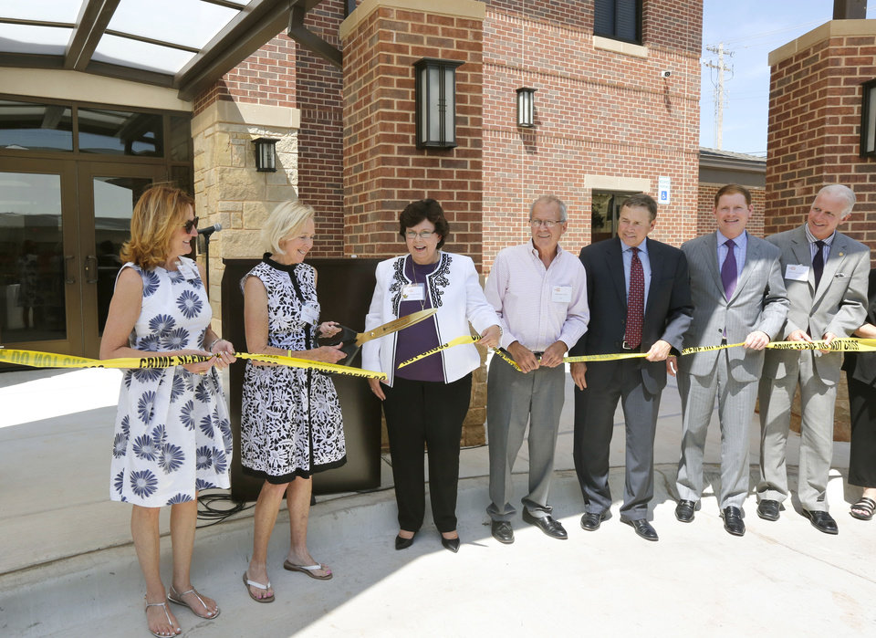 Photo -  Christy Everest and other dignitaries participate in a ribbon cutting for the new YWCA Thelma Gaylord Emergency Shelter in Oklahoma City, OK, Wednesday, September 2, 2015, Photo by Paul Hellstern, The Oklahoman