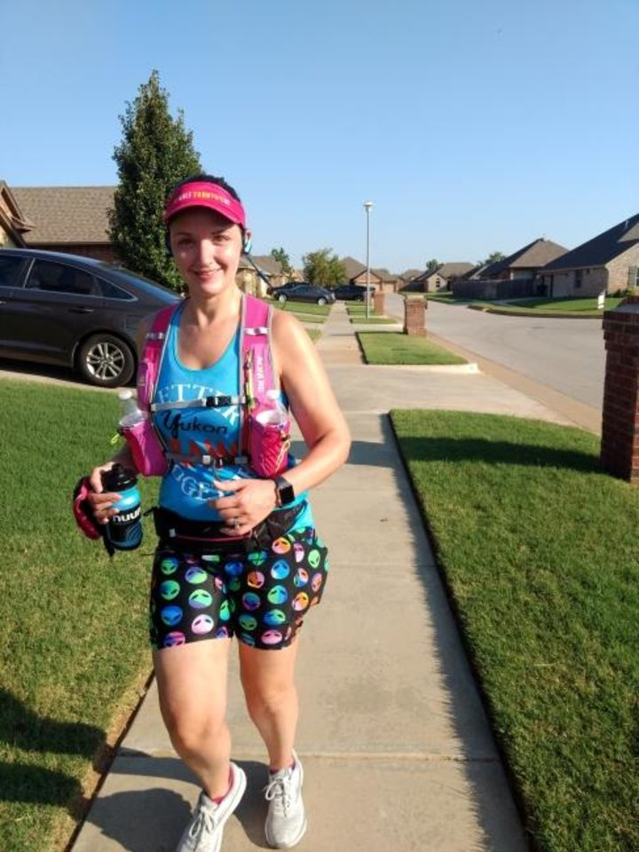 Photo -  Gretchen Phelps has trained for the Memorial Marathon by running through her neighborhood. Now that will be her marathon course Sunday with family, friends and neighbors cheering her on. [PHOTO PROVIDED]