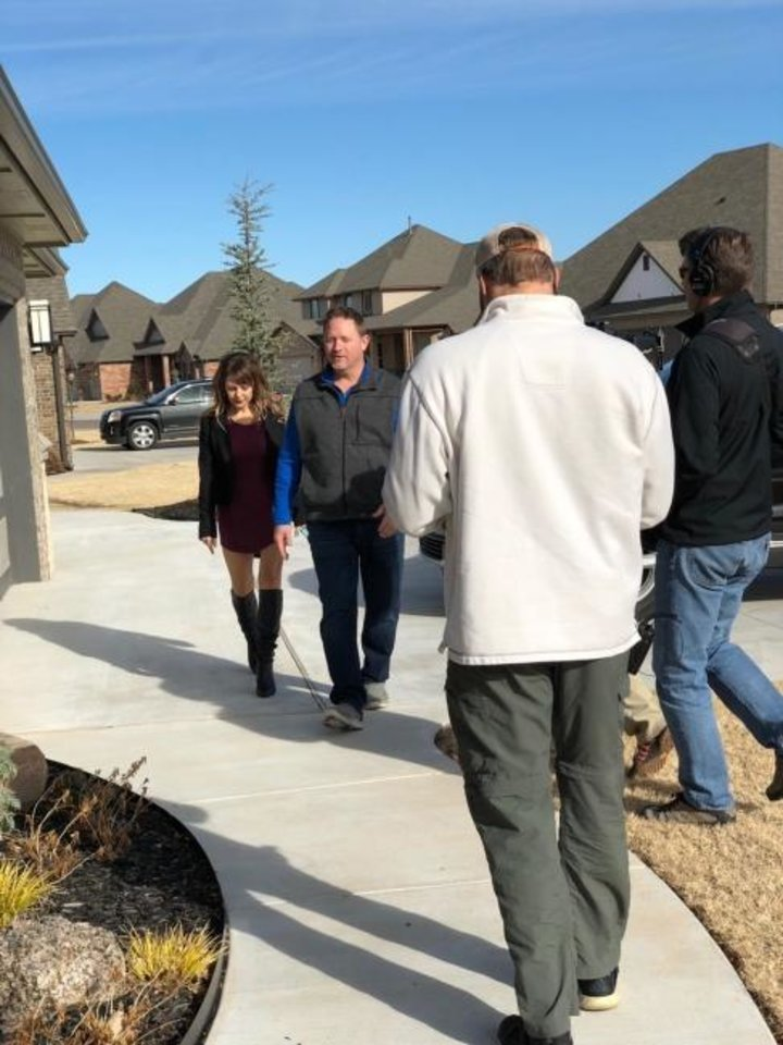 Photo -  Denise and Troy Schroder, left, walk a neighborhood for a new episode of
