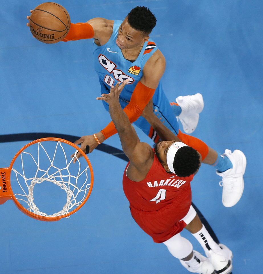 Photo - Oklahoma City's Russell Westbrook (0) goes to the basket past Portland's Maurice Harkless (4) during Game 3 in the first round of the NBA playoffs between the Portland Trail Blazers and the Oklahoma City Thunder at Chesapeake Energy Arena in Oklahoma City, Friday, April 19, 2019. Photo by Bryan Terry, The Oklahoman