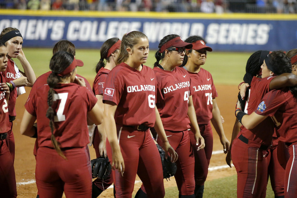 Photo - Oklahoma walks off the field after losing the second NCAA softball game in the championship series of the Women's College World Series between Oklahoma and UCLA at USA Softball Hall of Fame Stadium in Oklahoma City, Tuesday, June 4, 2019. UCLA won 5-4. [Bryan Terry/The Oklahoman]