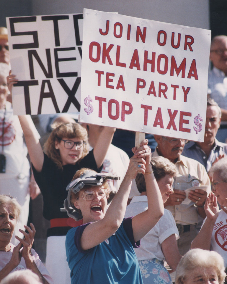 Photo - Picket sign in hand, Anne Burnett of Del City cheered a speaker at an anti-tax rally at the state Capitol. About 200 supporters of STOP New Taxes participated in the July 16, 1990, rally. [Photo by Jim Beckel, The Oklahoman Archives]