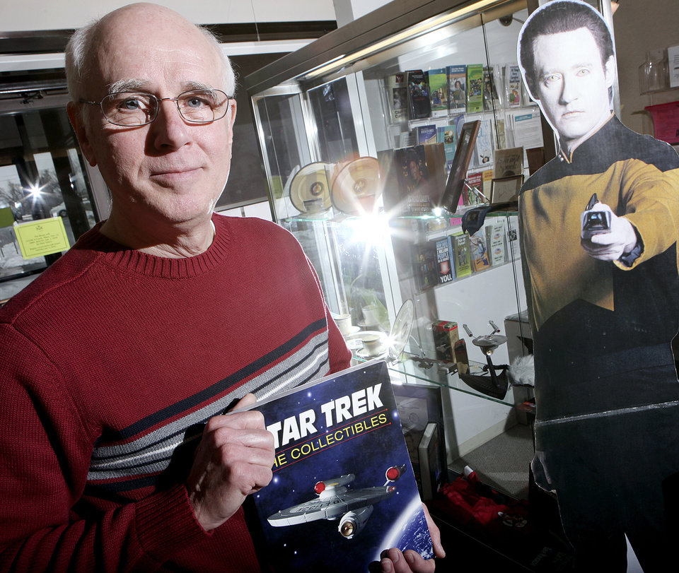 "Photo - Butch Roberts is shown at the Choctaw Library where his ""Star Trek"" collection is on display through Jan. 30.  PHOTOS BY JOHN CLANTON, THE OKLHOMAN"