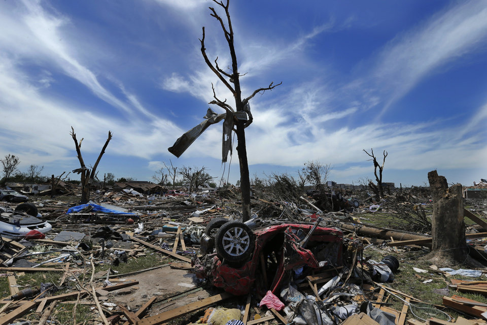 Photo - Monday's tornado damage is evident on Wednesday, May 22, 2013 in Moore, Okla. Photo by Steve Sisney, The Oklahoman
