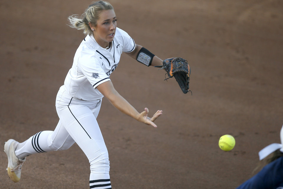 Photo - Oklahoma State's Sydney Pennington (21) throws the ball to first for an out in the first inning of the Stillwater Regional NCAA softball tournament game between Oklahoma State (OSU) and BYU in Stillwater, Okla., Thursday, May 16, 2019. [Bryan Terry/The Oklahoman]