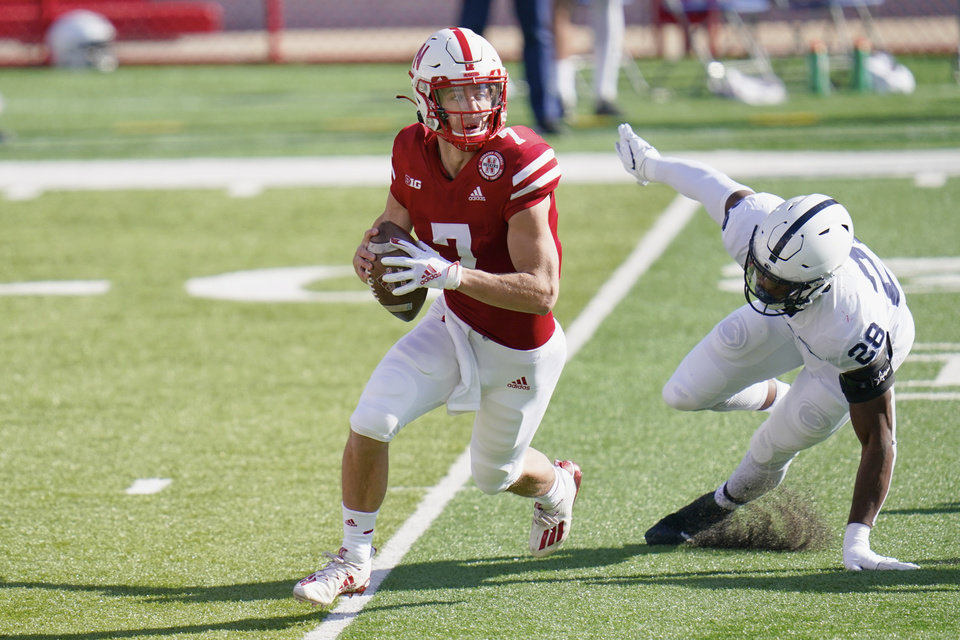 Photo -  Nebraska quarterback Luke McCaffrey (7) is pursued by Penn State defensive end Jayson Oweh (28) during Saturday's game in Lincoln, Neb. [AP Photo/Nati Harnik]