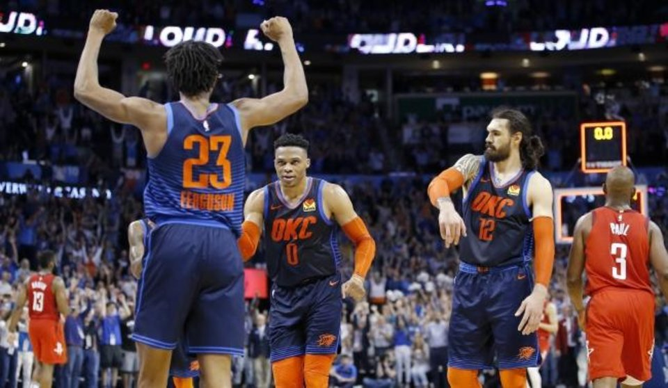 Photo -  Oklahoma City's Terrance Ferguson (23), Russell Westbrook (0) and Steven Adams (12) celebrate as Houston's Chris Paul (3) and James Harden (13) walk off the court Tuesday. [Sarah Phipps, The Oklahoman]