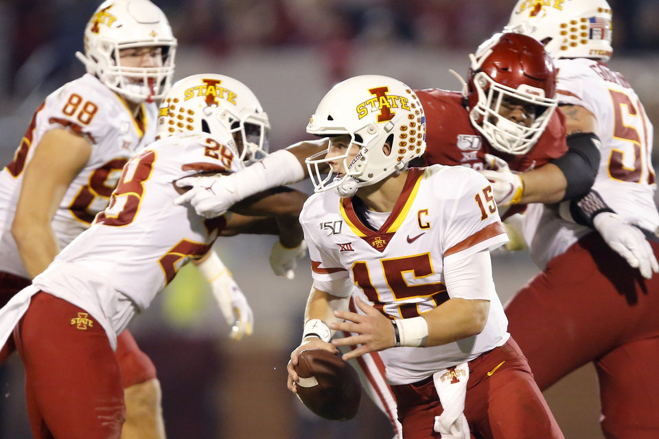 Photo - Iowa State's Brock Purdy (15) scrambles during an NCAA football game between the University of Oklahoma Sooners (OU) and the Iowa State University Cyclones at Gaylord Family-Oklahoma Memorial Stadium in Norman, Okla., Saturday, Nov. 9, 2019. [Bryan Terry/The Oklahoman]