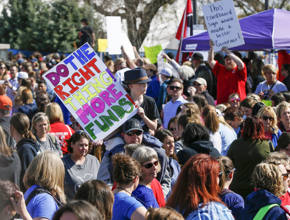 Photo - Teachers, students and supporters of increased education funding rally of the south side of the state Capitol during the eighth day of a walkout by Oklahoma teachers, in Oklahoma City, Monday, April 9, 2018. Photo by Nate Billings, The Oklahoman