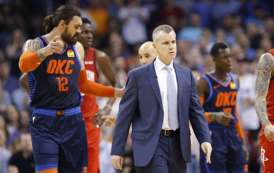 Photo - Oklahoma City head coach Billy Donovan walks off the court with Steven Adams after a scuffle during the NBA basketball game between the Oklahoma City Thunder and Houston Rockets at the Chesapeake Energy Arena, Tuesday, April 9, 2019. Photo by Sarah Phipps, The Oklahoman