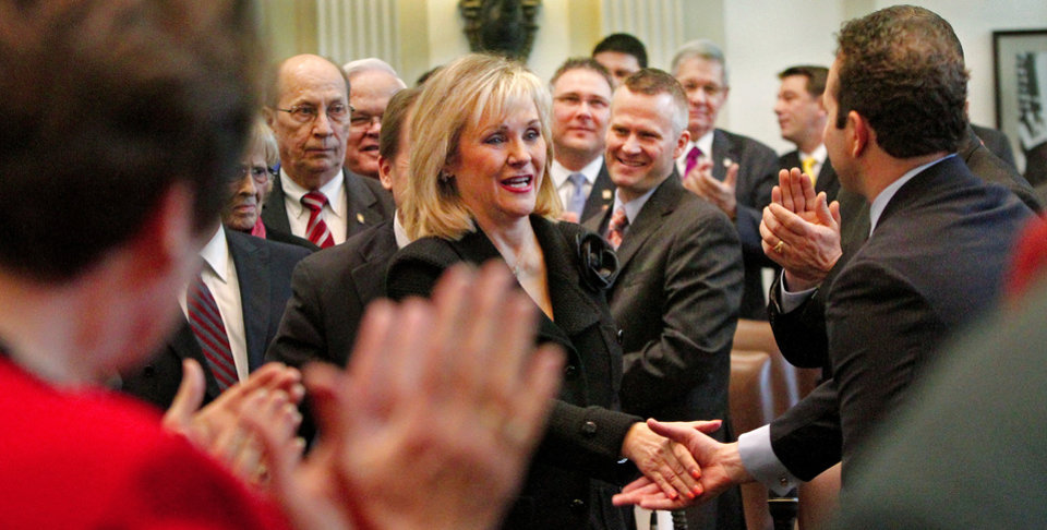 Photo - Gov. Mary Fallin is all smiles as she shakes hands of lawmakers on her way to the rostrum to deliver her 2012 State of the State address to a joint session of the Oklahoma legislature in the House Chamber on the opening day of the session, Monday, Feb, 6, 2012.   Photo by Jim Beckel, The Oklahoman