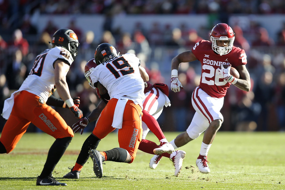 Photo - Oklahoma's Kennedy Brooks (26) carries the ball during a Bedlam college football game between the University of Oklahoma Sooners (OU) and the Oklahoma State University Cowboys (OSU) at Gaylord Family-Oklahoma Memorial Stadium in Norman, Okla., Nov. 10, 2018.  Photo by Bryan Terry, The Oklahoman