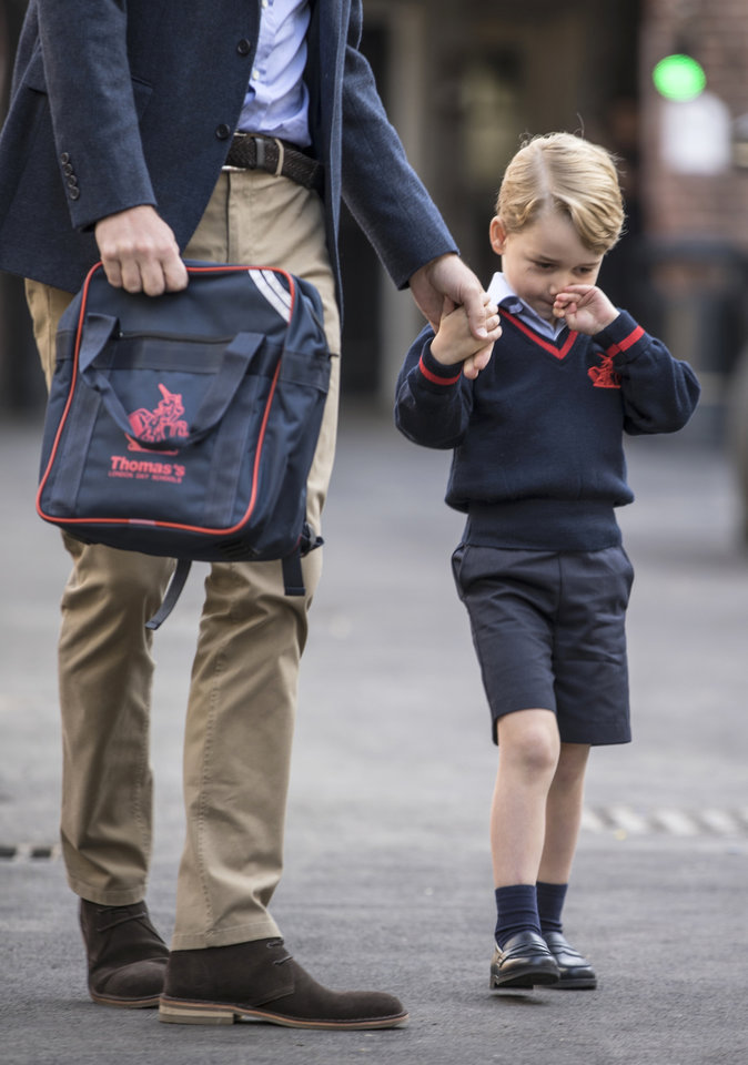 Photo - Britain's Prince George arrives for his first day of school at Thomas's school in Battersea, London, Thursday, Sept. 7, 2017.  Prince William's pregnant wife Kate was too ill with morning sickness Thursday to take young Prince George to his first day of school.  Prince William's pregnant wife Kate was too ill with morning sickness Thursday to take young Prince George to his first day of school. (Richard Pohle/Pool Photo via AP)