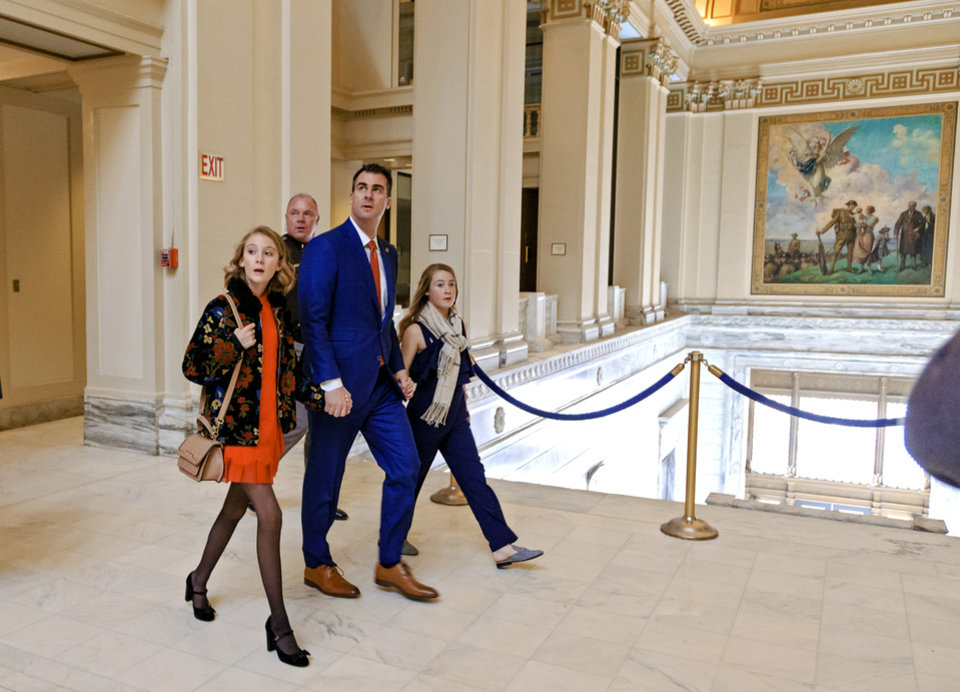 Photo - Gov. elect Kevin Stitt, walks with his daughter Katie, left, and Piper as he arrives with his family for his inauguration ceremony at the Oklahoma State Capitol in Oklahoma City, Okla. on Monday, Jan. 14, 2019.  Photo by Chris Landsberger, The Oklahoman