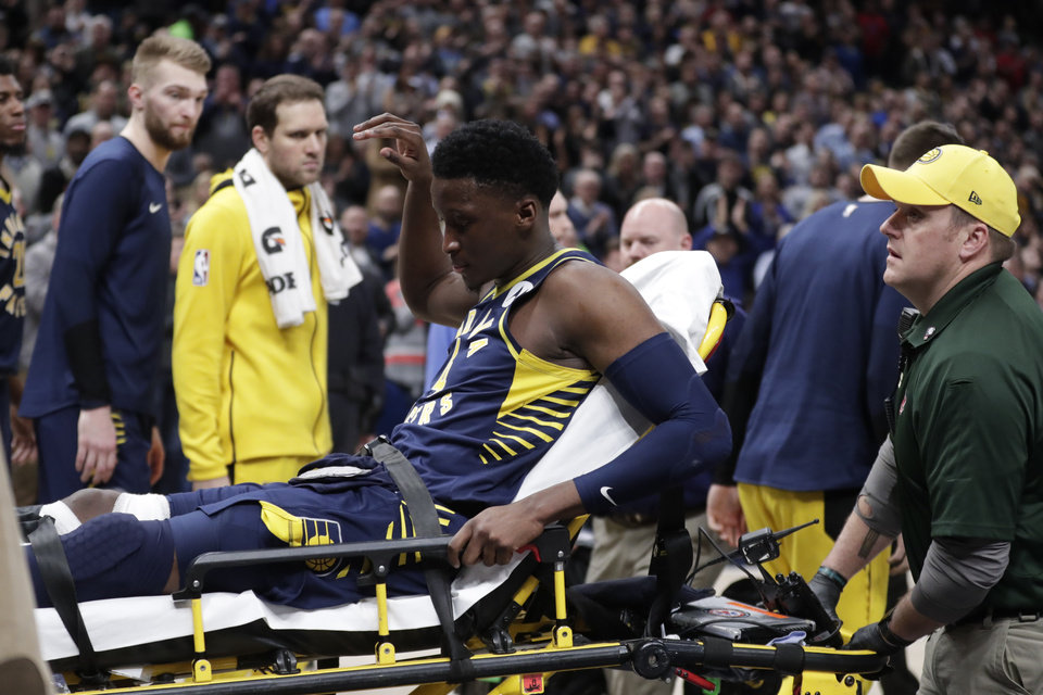 Photo - Indiana Pacers guard Victor Oladipo is taken off the court on a stretcher after he was injured during the first half of the team's NBA basketball game against the Toronto Raptors in Indianapolis, Wednesday, Jan. 23, 2019. (AP Photo/Michael Conroy)