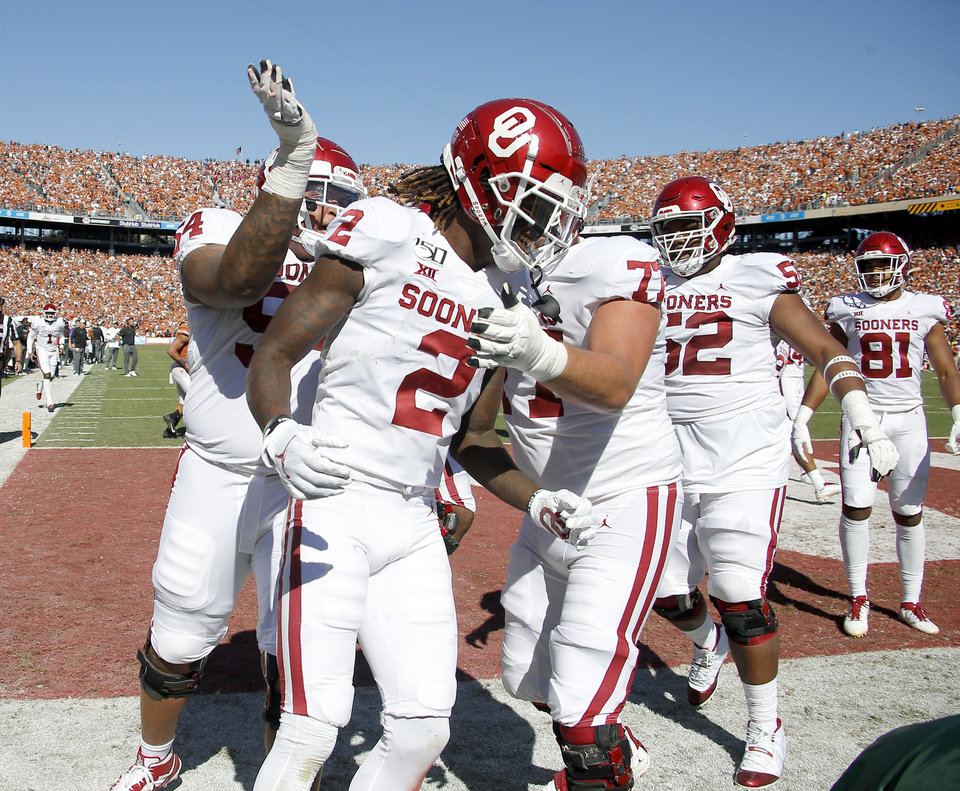 Photo - Oklahoma wide receiver CeeDee Lamb (2)  celebrates after a touchdown during the Red River Showdown college football game between the University of Oklahoma Sooners (OU) and the Texas Longhorns (UT) at Cotton Bowl Stadium in Dallas, Saturday, Oct. 12, 2019. [Bryan Terry/The Oklahoman]