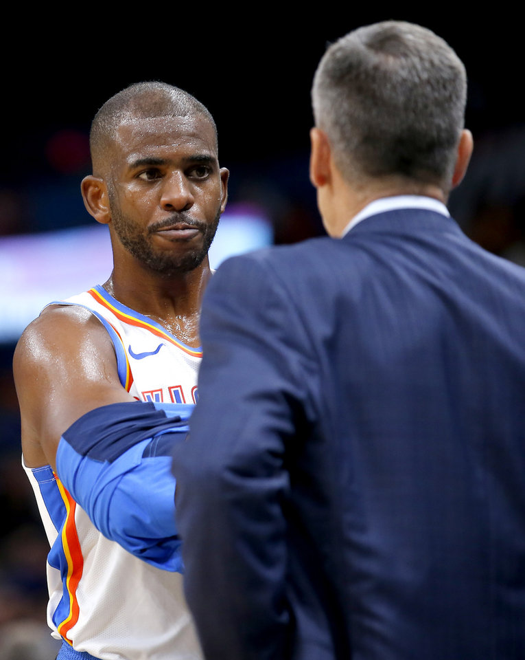 Photo - Oklahoma City's Chris Paul (3) talks with head coach Billy Donovan during the NBA preseason game between the Oklahoma City Thunder and the New Zealand Breakers at the Chesapeake Energy , Thursday, Oct. 10, 2019. [Sarah Phipps/The Oklahoman]